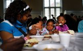 WATERBURY, CT - MAY 20: Kelly Cooper eats lunch with three of her children at a soup kitchen run by Greater Waterbury Interfaith Ministries on May 20, 2013 in Waterbury, Connecticut. Waterbury, once a thriving industrial city with one of the largest brass manufacturing bases in the world, has suffered economically in recent decades as manufactoring jobs have left the area. According to recent census data, 20.6%. of the city's residents were living below the poverty level. Greater Waterbury Interfaith Ministries provides 579 meals daily to Waterbury's neediest residents Sunday through Friday, representing a 19% increase over the same period last year. (Photo by Spencer Platt/Getty Images)