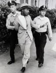 04 Sep 1958, Montgomery, Alabama, USA --- Police officers O.M. Strickland and J.V. Johnson apply force in arresting the Reverend Martin Luther King for loitering near a courtroom where one of his integration lieutenants was on the stand. King charged he was beaten and choked by the arresting officers. Police denied the charges. --- Image by © Bettmann/CORBIS
